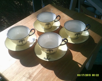 Set Of Four Royal Doulton Tea Cups and Saucers