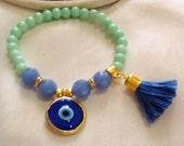 Evil eye and tassel bracelet , bohemian bracelet , gypsy bracelet , Turkish bracelet , ethnic bracelet