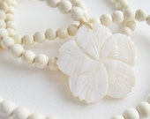 Bohemian necklace with mother of pearl flower...