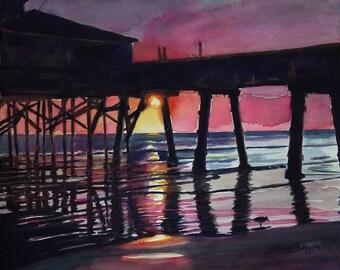 Morning glow. Original watercolor painting of the sunrise at Sunglow Pier, Daytona Beach Shores, Florida
