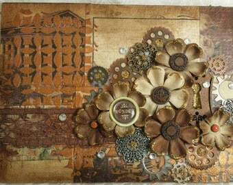 Wonder - a mixed media altered canvas with paper flowers and glittered bits amid a steampunk motif.