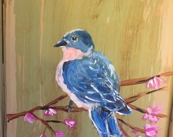 Bluebird painting on wood cabinet