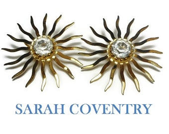 """Sarah Coventry earrings,  1959 Fascination probably not the Dainty Fascination,  large 2"""" starburst gold tone clip earrings, crystal center"""