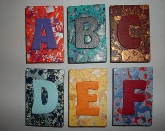 "colorful handpainted wood alphabet magnets, unique ""marble"" & splatter finishes"