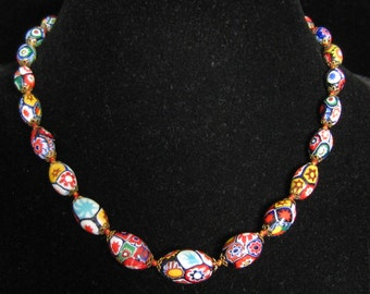 """17.5"""" Graduated Millefiore Oval Bead Necklace. Tiny Brass Bead Caps Throughout. Knots/Stringing done with Both Red AND Golden Yellow Threads"""