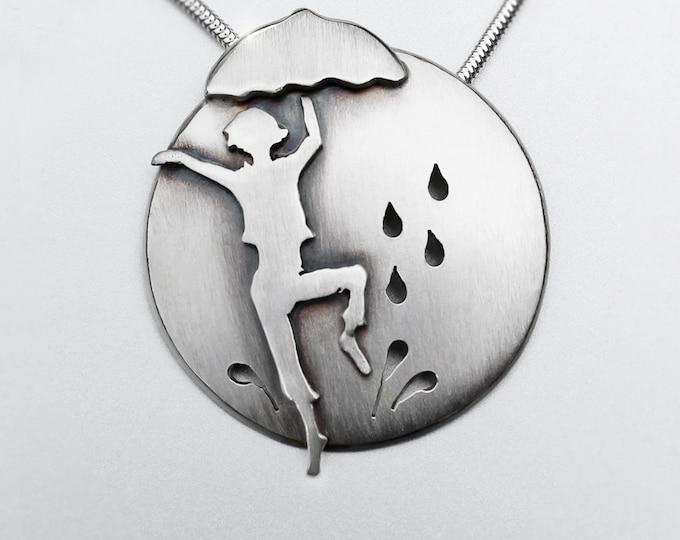 Dancing in the Rain, Silver Pendant, Silver Jewellery, silver jewellery, singing in the rain necklace.