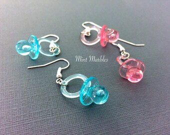Pink or Blue Baby Pacifier Earrings. Dangle Drop Earrings. Lightweight. New Mom. Mommy to Be. Mother. Babies. Under 10 Gifts. Cute. Sweet.