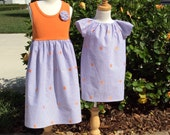 SISTER SET for CLEMSON! Pair our flutter sleeve Phoebe with our tank dress..in purple seersucker with orange embroidered tiger paw