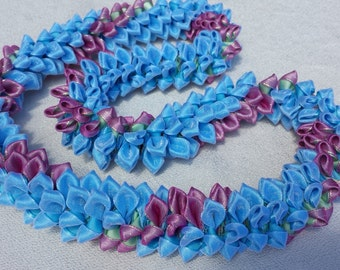 Pale blue pink sky ribbon lei