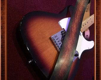 Genuine Leather Hand-Made Guitar Strap.  Great coordinating color to match your guitar.  Can be personalized too! Great gift idea!