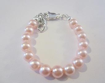 Newborn babies pink pearl bracelet