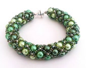 Hand Woven 6mm Shades of Green Glass Pearl Bracelet with matching Toho seed beads, metallic accent beads, silver magnet clasp