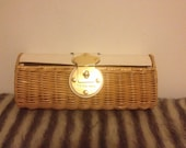 Wicker clutch with clasp