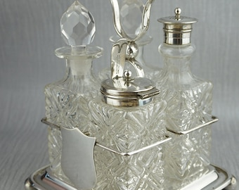 Victorian ISG Israel Sigmond Greenberg Glass and Silver Plated Cruet Serving Set with Sheild on Front of Holder