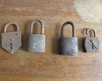 RUSTY four antique padlocks of varying ages , free uk postage
