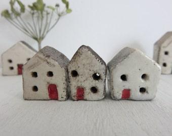 Trio of tiny ceramic houses