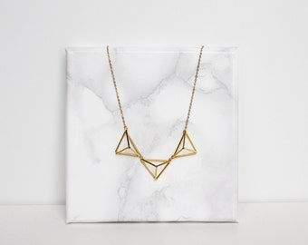Himmeli inspired geometric bunting necklace. Gold or silver tone