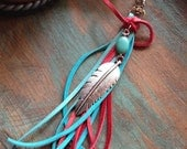 On Sale Western silver feather with red and turquoise deerskin leather purse tassel