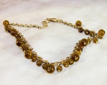 Tiger Eye Glass Bracelet         8 Inch  2 Inch Extension  Silvertone