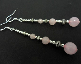 A pair of pretty pink jade   bead silver plated long dangly earrings.