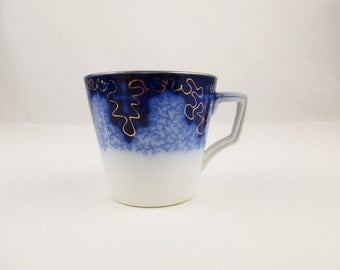 Pick a Cup - An Antique Flow Blue Cup - Unmarked - Porcelain Cup With Gold Looping Pattern - Light Cobalt Blue Cobweb Pattern
