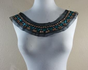 Shine beads round neck on black mesh applique trim.