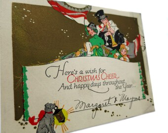 1920's Card Collection | Charming Embossed Christmas Card Featuring Christmas Carolers and their Amazing Trained Lantern Holding Dog