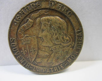 St.Jeanne D'Arc Religious Medal with scares La Patrie Newspaper Token on reverse side .