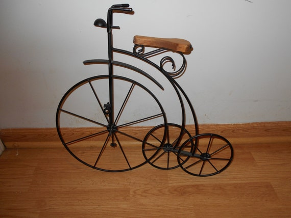 Black wrought iron bicycle with wood seat wall art - Wrought iron bicycle wall art ...