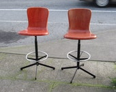 SOLD OUT.   Pair of Orange Mid Century Fiberglass Swivel Back Bar Stools  Excellent Vintaqge Condition