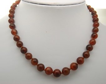 A realy superb vintage jewelry necklace of natural graduated cornelian type semi precious beads individually knotted