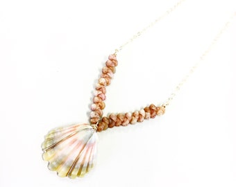 V-shaped Ni'ihau shell necklace fearturing a Kauai sunrise shell