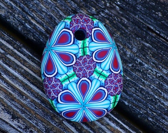 Red and Blue handmade kaleidoscope polymer clay pendant