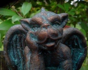 Small Gargoyle cement statue hand finished in bronze aged patina.
