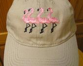 Four Flamingos On a Tan B...