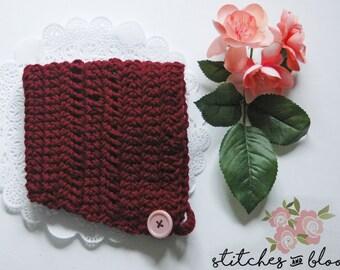 Crocheted burgundy baby bonnet