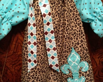 This peasant dress has Aqua Fleur de Lis on a Cheetah dress with aqua & brown dot quarter length sleeves.