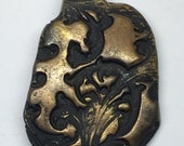 Artisan designed textured polymer clay pendant in bronze finish