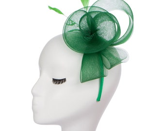 Green fascinator hat with mesh and feather detail