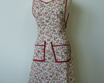 WWII style, new apron.  Cream with floral print and brick trim.