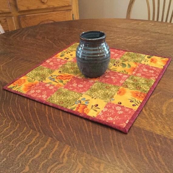 Quilted Candle Mat, quilted table mat, quilted table topper, table topper, patchwork candle mat, brown, cranberry, orange, gold, cream