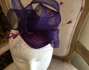 Purple fascinator/hatinator with loops, feathers and netting! One only!