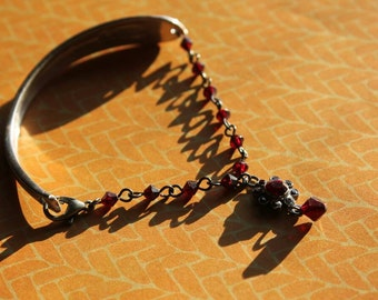 Upcyled spoon handle bracelet with ruby red beads