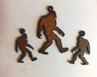 Sasquatch charm with matching earrings made out of rusted metal