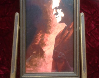 Frankenstein standing in smoky background  print in an wooden antique swivel picture frame