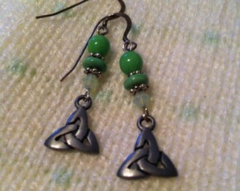 Green mix and silver pierced earrings with Celtic Trinity charms.