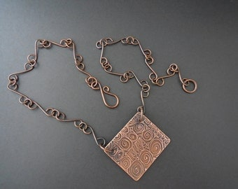 Whimsical swirl design copper etched pendant with copper chain
