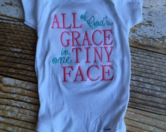 All Gods grace in one tiny face embroidered onesie