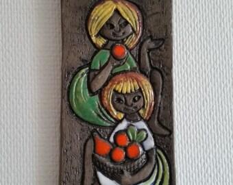 Relief Scandinavian midcentury art by Ninnie Forsgren Atelje. Ceramic plaque. Orange apples wall hanging with girls.