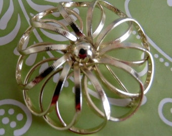 Elegant, puff flower in gold tone metal.  It has tiny striations in the metal for a bit of bling